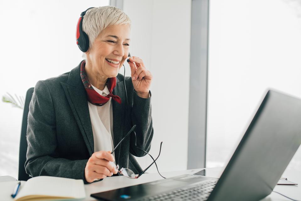 Senior woman at call center