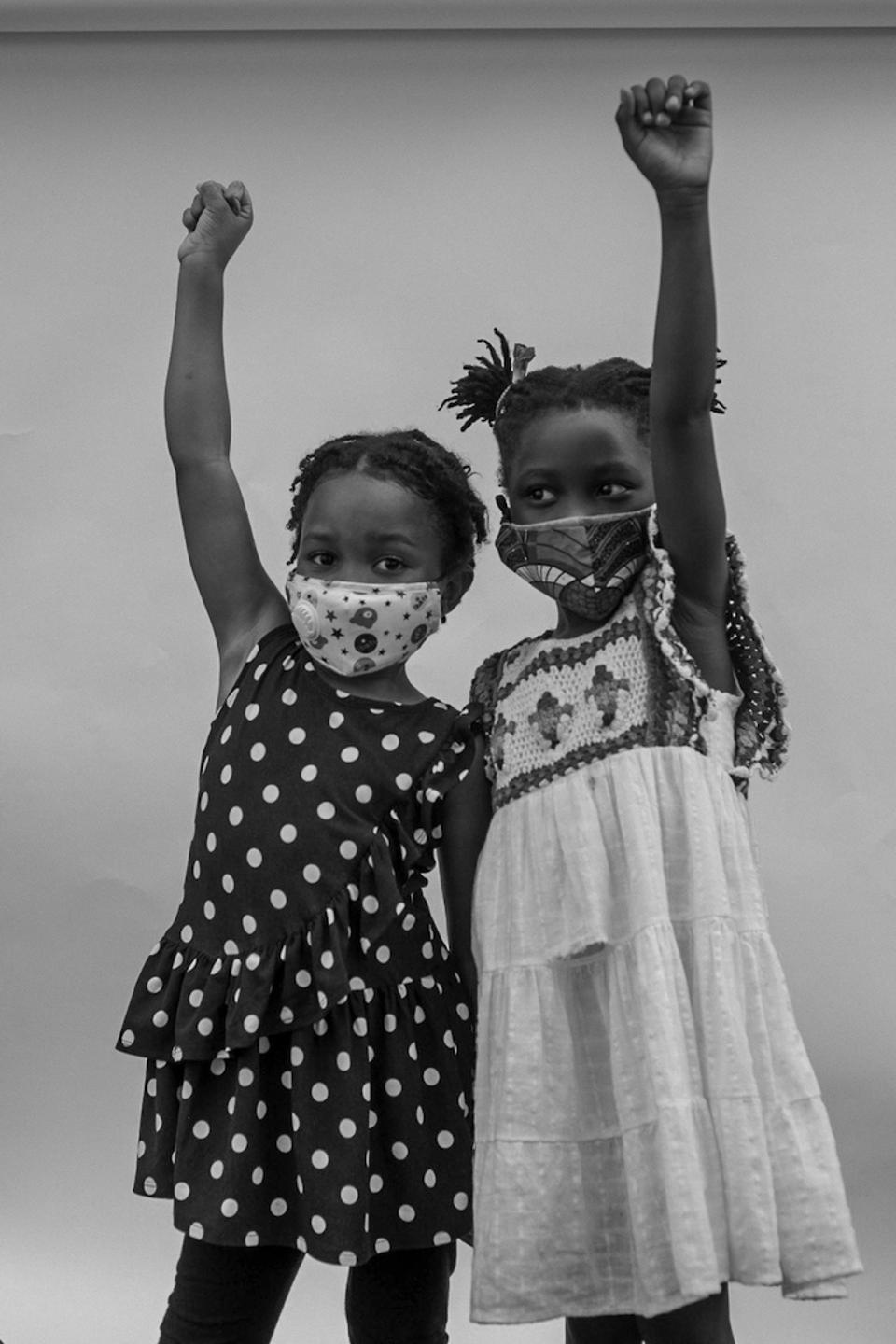 Friends Kennedy (left) and Amina reunited at the Children's March outside the Brooklyn Public Library in Brooklyn, New York in June, 2020.
