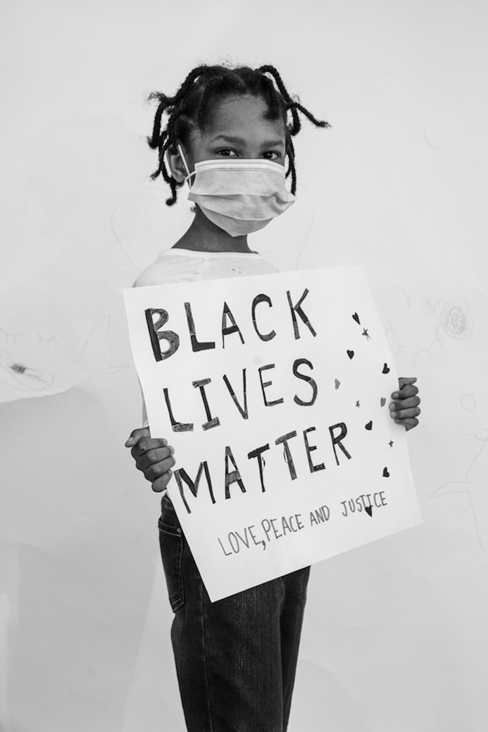 Nayla, 6, at the Stroll for Freedom in Bed-Stuy in Brooklyn, New York in June 2020.