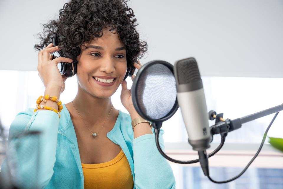 New Heartland Millennial business woman recording her podcast.