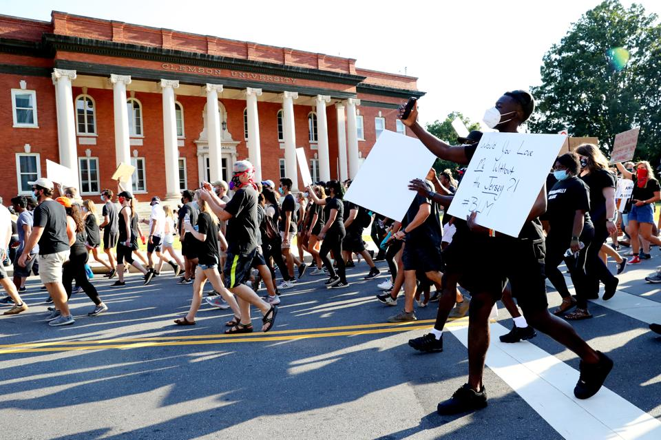 Clemson University Football Team Lead Protest March After Death Of George Floyd