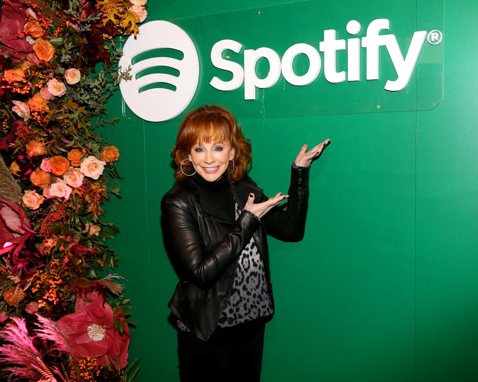 Country music icon Reba McEntire celebrating her forthcoming podcast Spotify.