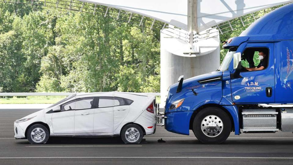 A passenger vehicle gets rear-ended by a large truck.
