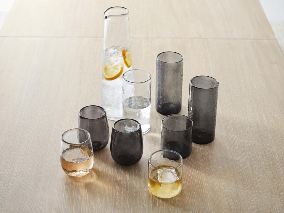 A beautiful hammered glassware collection with stemless wine glasses, highball and rocks.