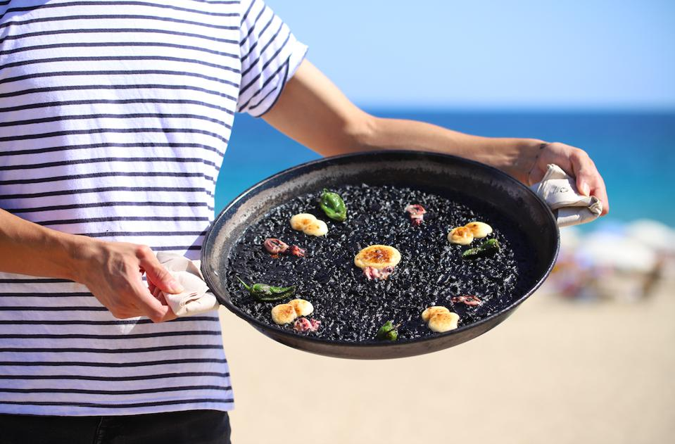 Black rice paella with baby squid, toasted alioli and Padrón peppers at Can Fisher, Barcelona