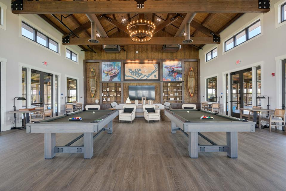 Delta Cove's Island Camp is a 15,000-square-foot complex that offers fitness, movement and swimming facilities (including a toddler pool), fire pits, and a boat-themed bar. Seen here is its games pavilion.
