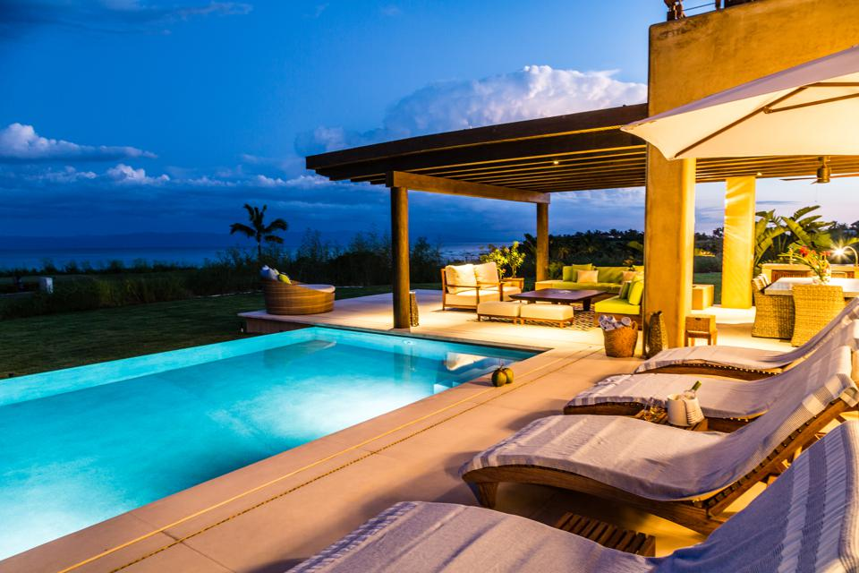 Located in one of the most sought-after developments at Punta Mita, this beautifully constructed five bedroom, five-and-a-half bathroom stucco home was built in 2016. The villa boasts 5,590 square feet of interior space.