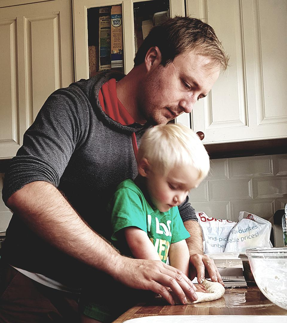 Hold Still, father and toddler making bread