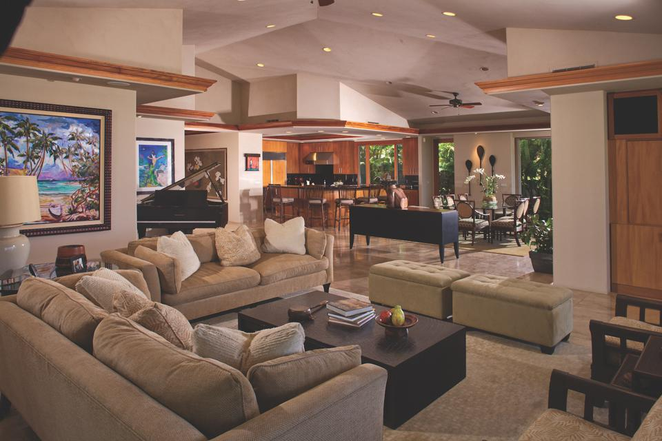 Interior appointments feature a collection of fine artwork and furnishings that complement the homes tropical ambiance.