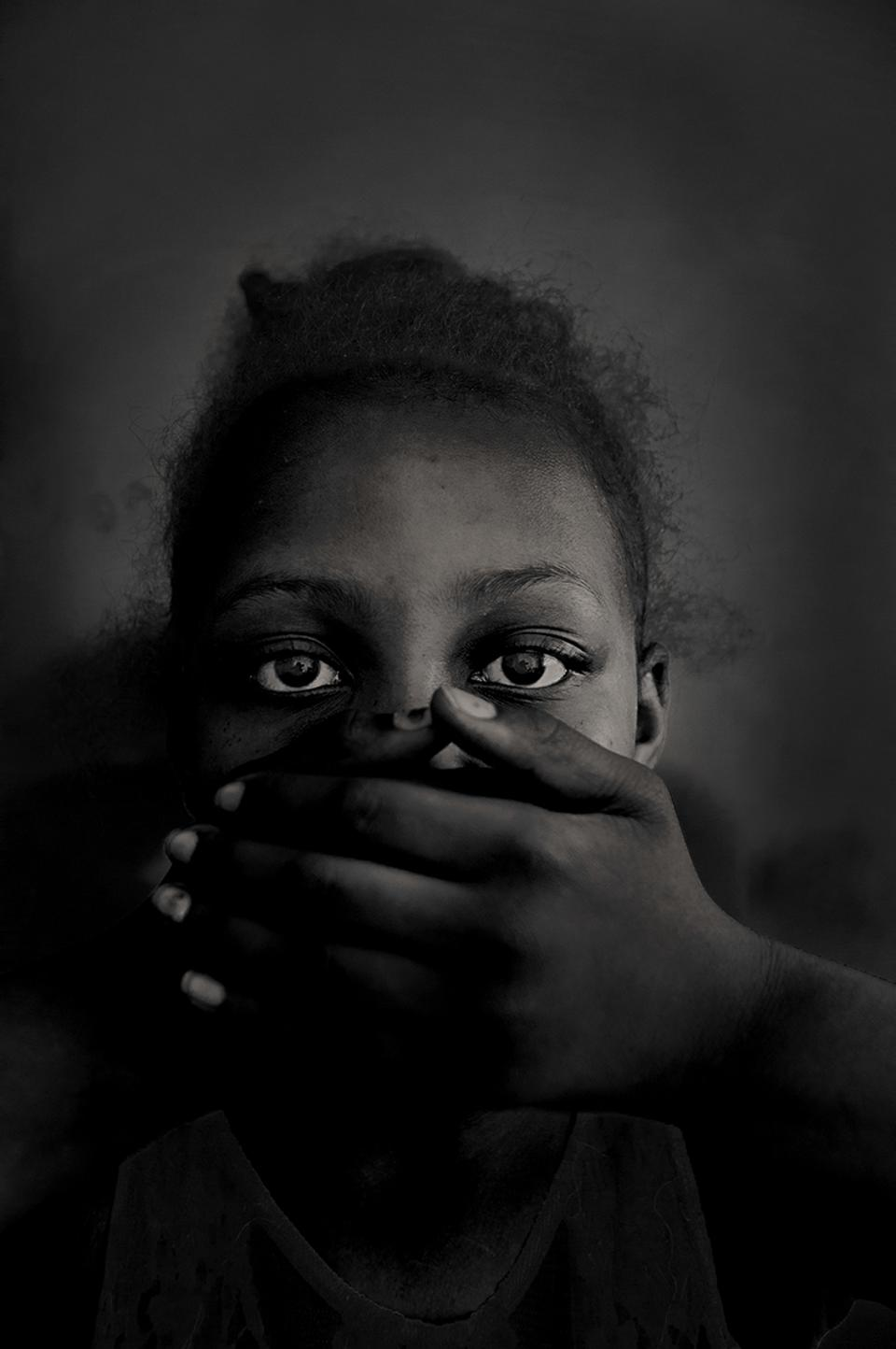 Hold Still portraits exhibit, black girl with hands covering mouth