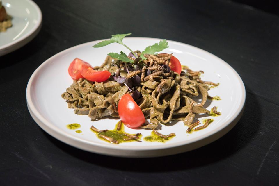 Basil pesto tagliatelle made with ground black soldier fly larvae and garnished with mealworms