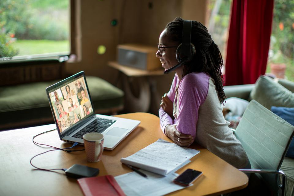 Woman works from home on remote virtual team during coronavirus quarantine