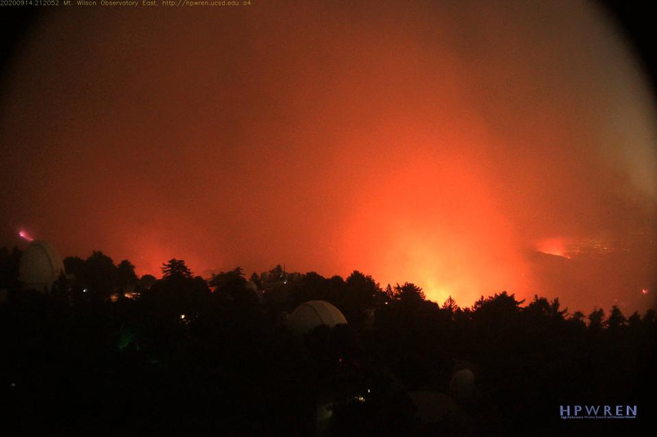 A photo from the HPWREN cameras posted atop Mount Wilson Observatory, showing wildfires.