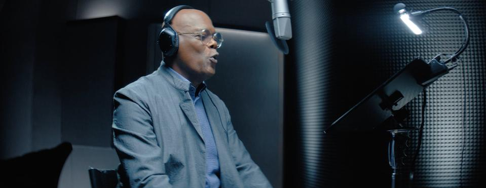 Legendary actor Samuel L. Jackson sitting in a voice booth recording his Alexa responses.