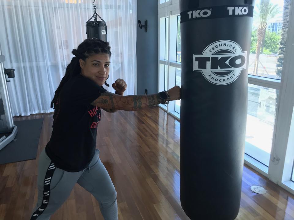 Melissa Hernandez training with the heavy bag