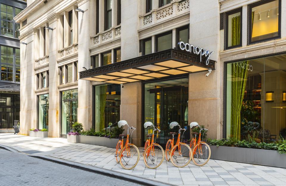 orange bikes in front of hotel in philadelphia