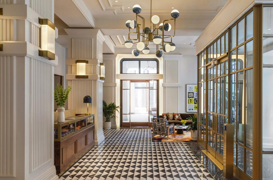 lobby hotel with marble floor and quirky chandelier