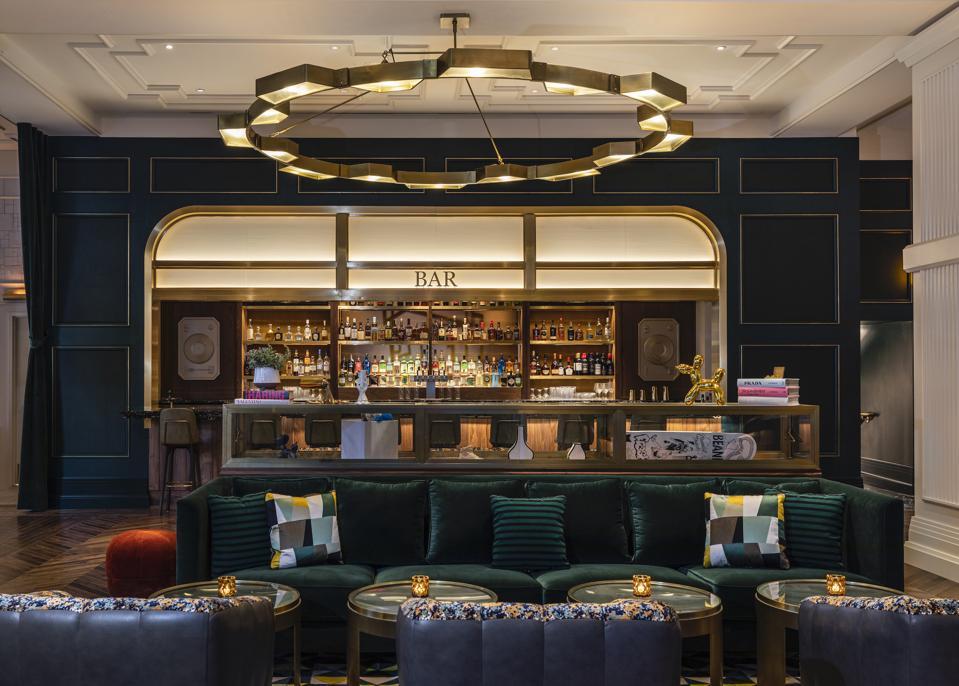 hotel bar with green velvet sofa