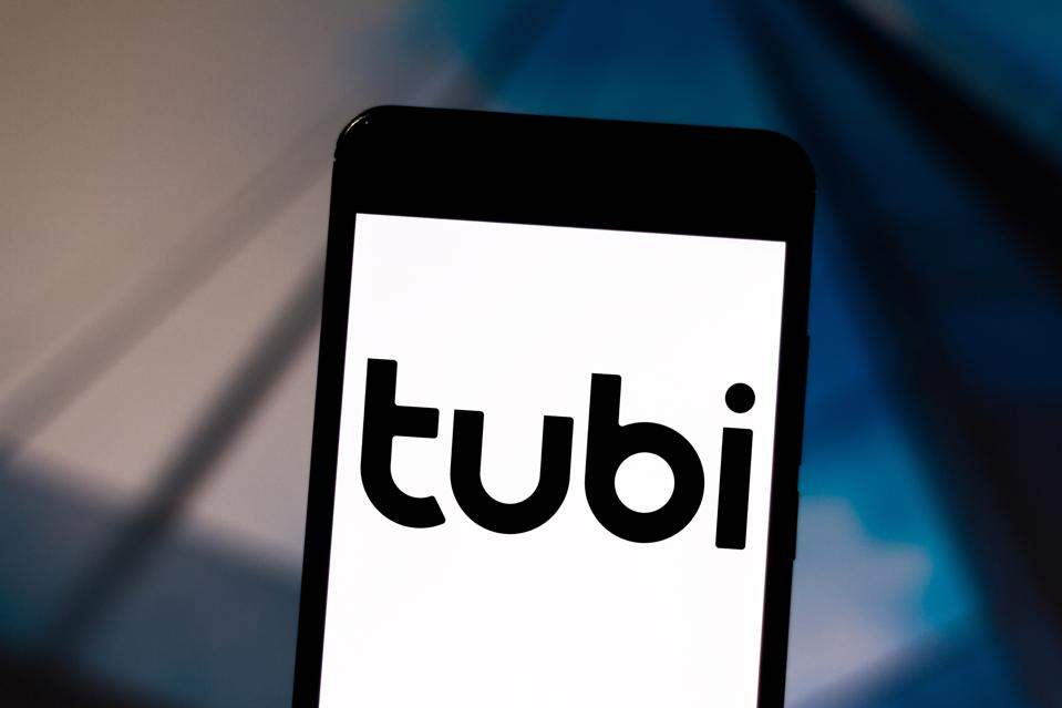In this photo illustration a Tubi logo seen displayed on a...
