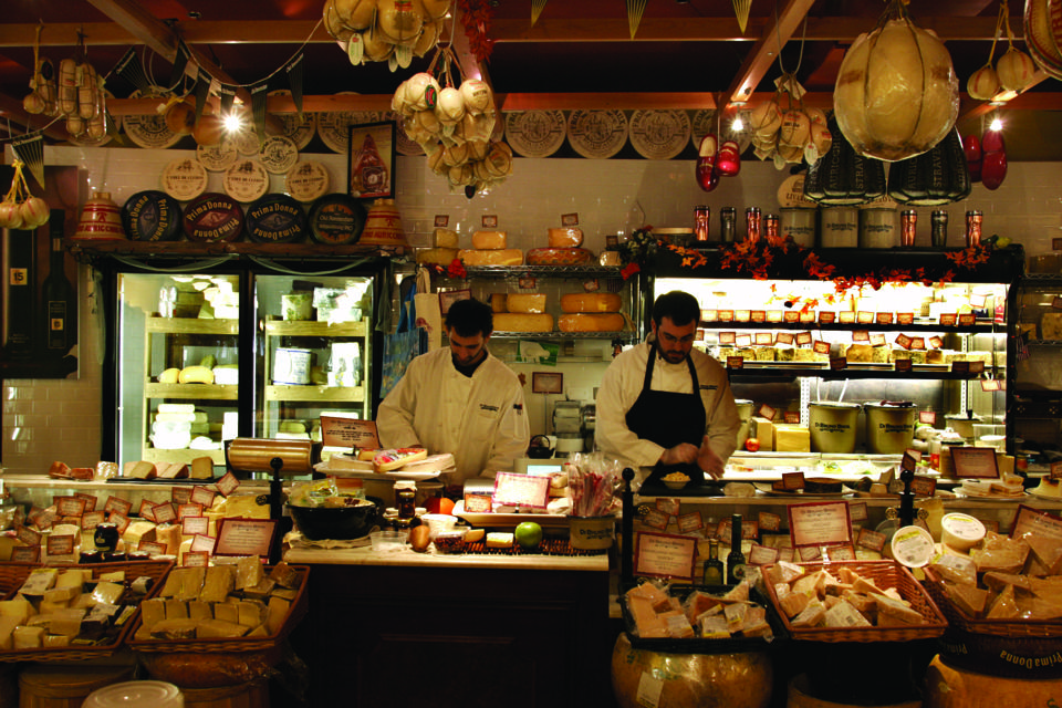cheese counter with two men working