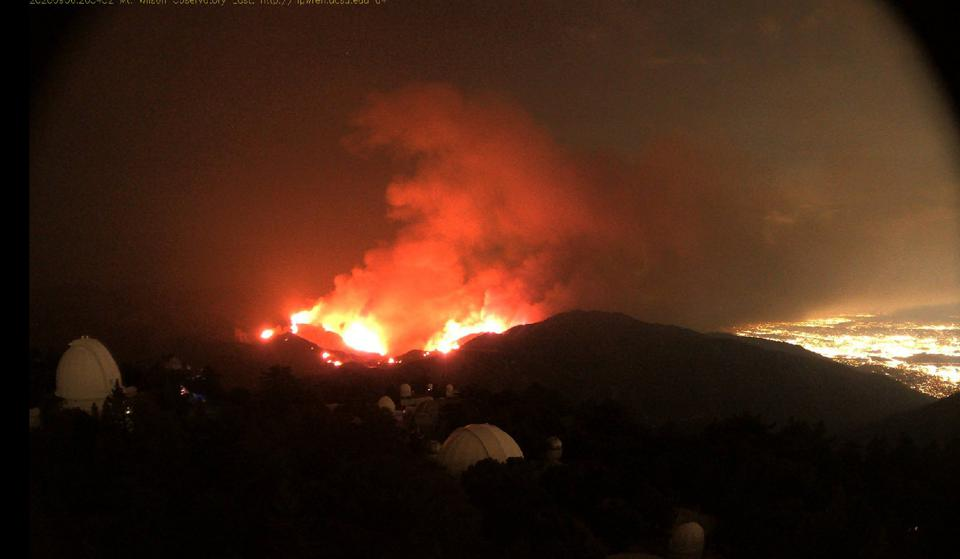 Photo from the HPWREN cameras atop Mount Wilson, showing approaching wildfires.