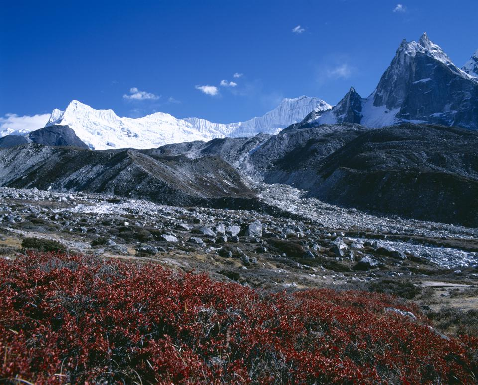 Himalayan mountain peaks with glacial debris in the foreground
