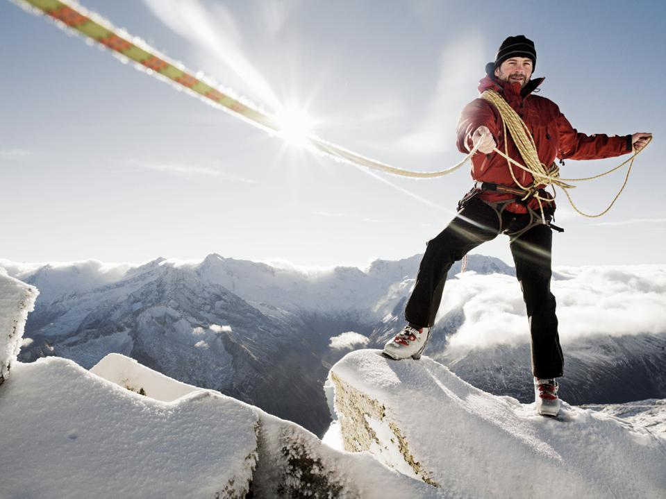 Austria, Tirol, Hintertux Glacier, mountaineer with rope (lens flare)