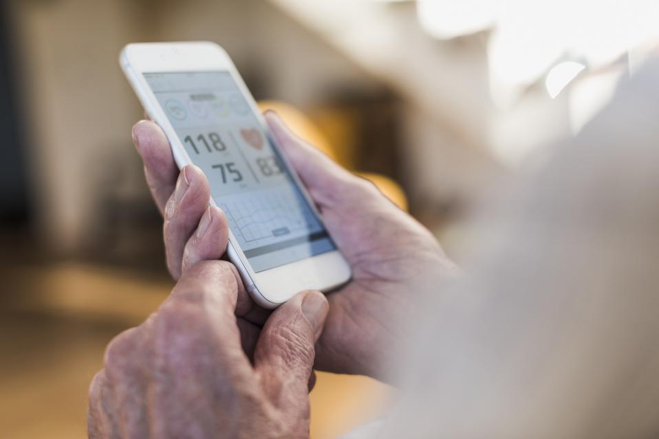 Senior man using smart phone app