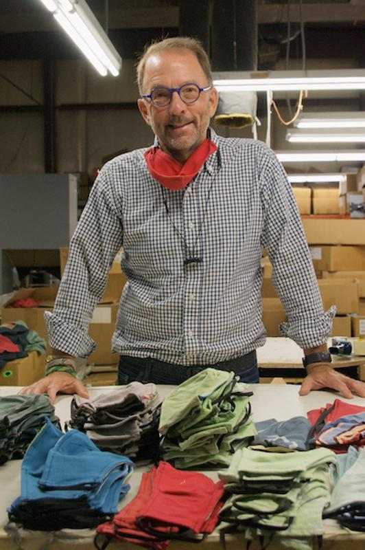 Eric Henry, CEO TS Designs with facial masks cut from t-shirts.