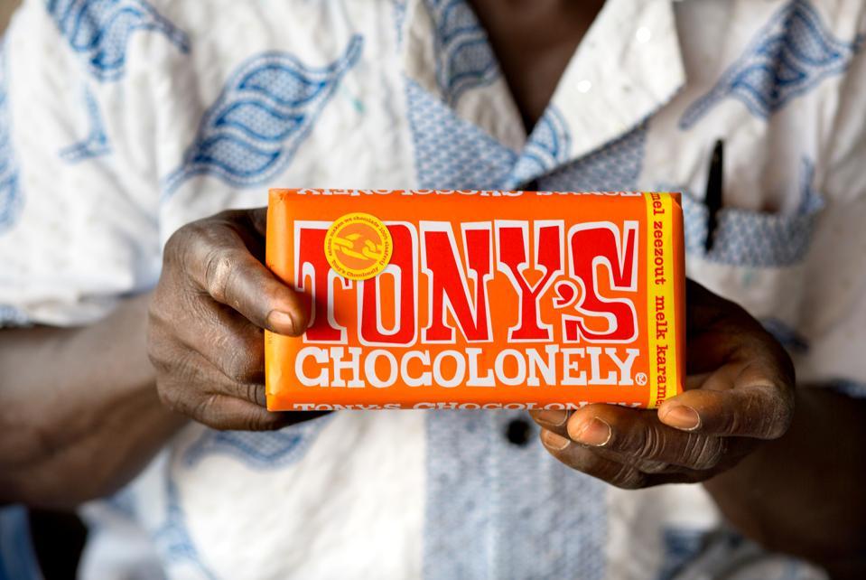 Man holding chocolate bar