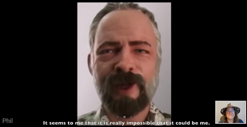 A virtual model of Philip K Dick's head, with Dr Ben Goertzel in the corner, looking skeptical