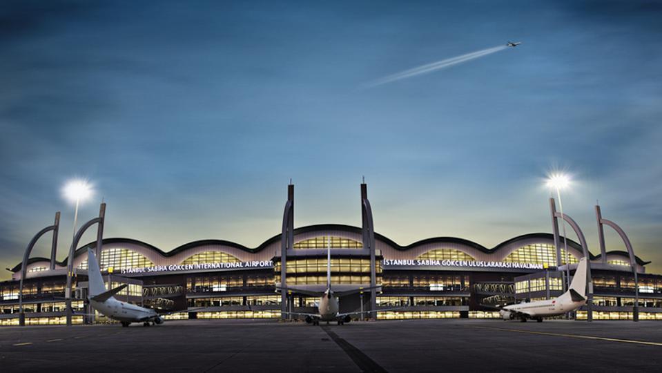 Sabiha Gökçen Airport terminal exterior with three planes
