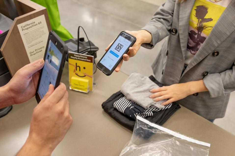 a customer processing a Happy Return
