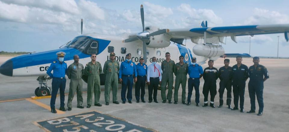 Crew from the India Coastguard in front of the dornier aircraft used to combat the fire on the MT New Diamond.
