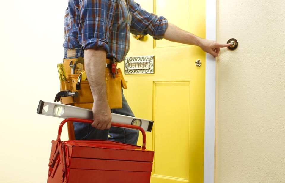 Repairman arriving at a front door