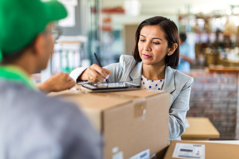 Courier collecting or delivering parcels from small business
