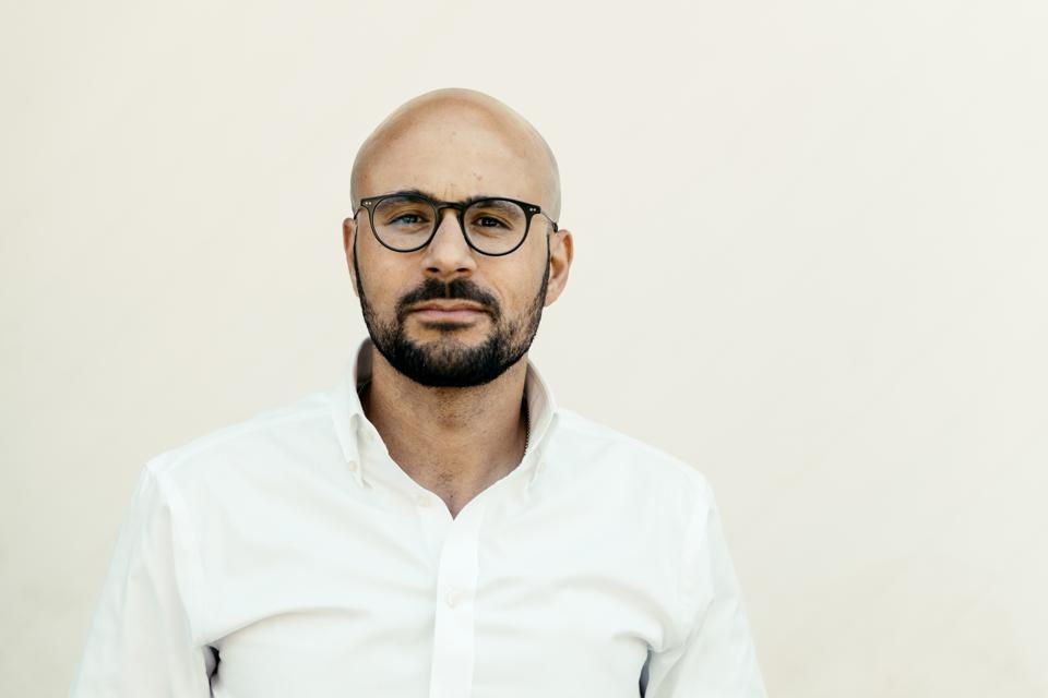 bald man with beard and glasses