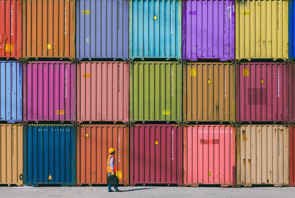 Maintanence worker working with cargo containers