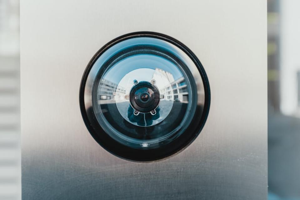 A camera lense, surveying you.