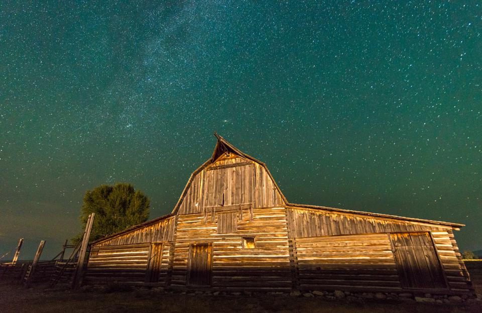 Celestial skies open up above T.A Moulton Barn, Grand Tetons National Park, Teton County, Wyoming