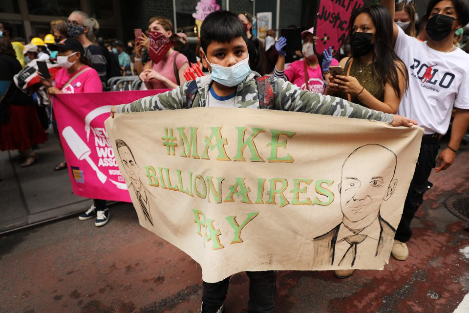 Activists March In Manhattan Calling For A Tax On Billionaires