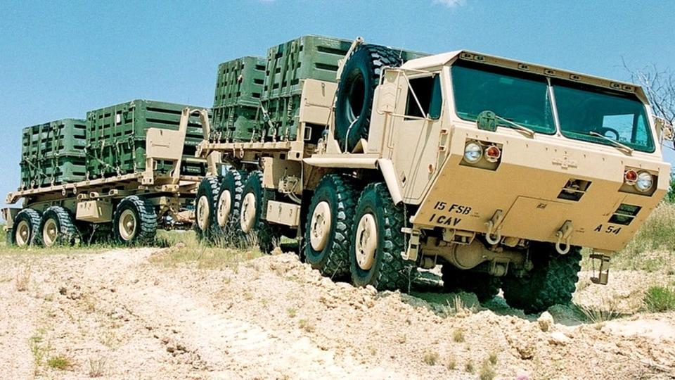 U.S. Army Oshkosh PLS A1 resupply vehicles.