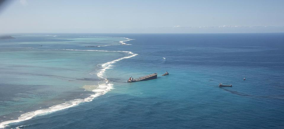 9 Aug: The thin film of oil was seen drifting well outside of Mauritius coral lagoon.  Seen here in image from France Ministry of Defense.
