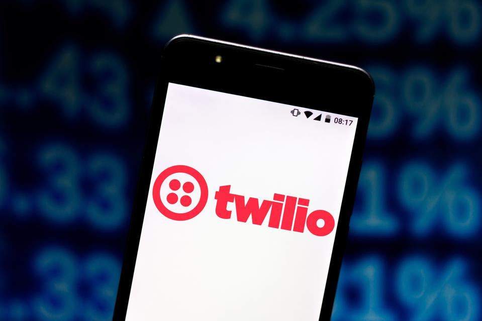 In this photo illustration a Twilio logo seen displayed on a...