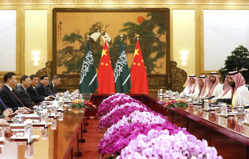 Saudi Crown Prince Mohammad bin Salman, right, speaks to Chinese President Xi Jinping, left, during a meeing at the Great Hall of the People in Beijing, Friday, Feb. 22, 2019. Prince Mohammad is in China as part of a tour of Asian countries. (How Hwee Young/Pool Photo via AP)