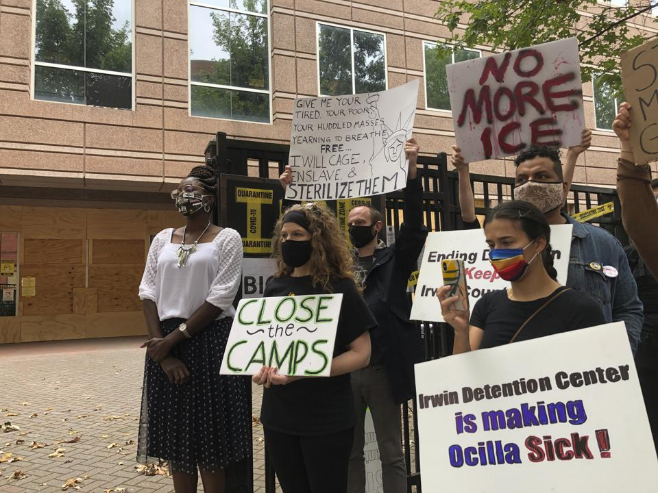Dawn Wooten, and others protesting conditions at an immigration detention facility.