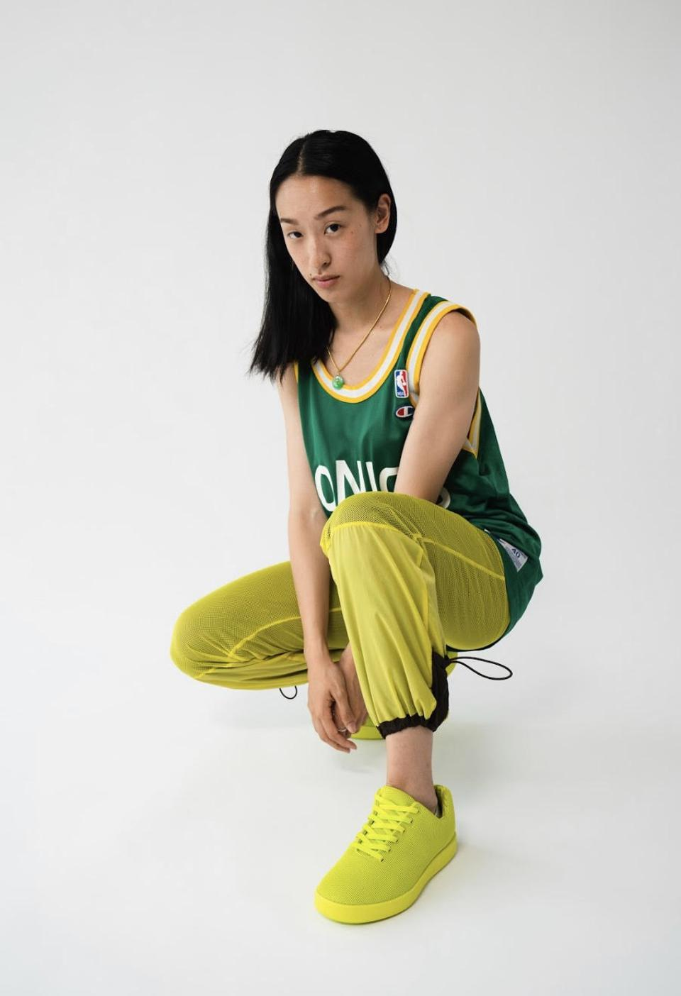 A model in a pair of Atoms' limited edition neon sneakers.