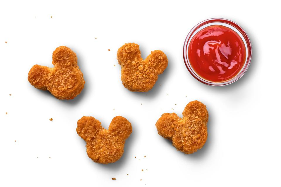 New plant-based nuggets shaped like Mickey Mouse are made for dipping.