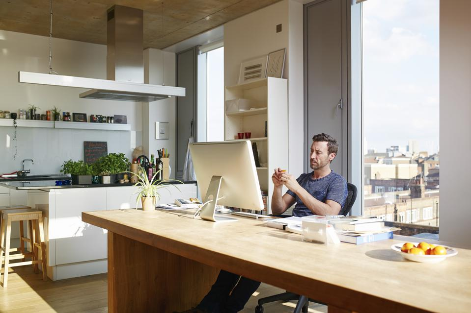 Many using computer in apartment