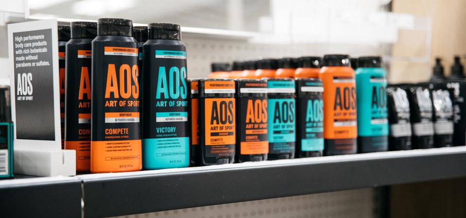 A shelf at a Target store showing Art of Sport body wash ans skincare products.